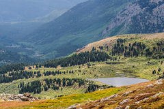 Mountain field and lake - mt evans colorado. Mount evans colorado landscape - mountain forest field and lake in late summer with some fall colors starting to royalty free stock photos
