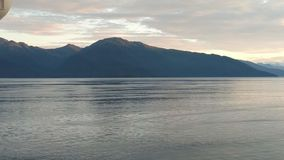 Mountain Filled horizon on the pacific ocean. Inside passage Alaska stock photography