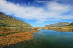 Mountain and fjord landscape, norwegian sea at Holandsmelen, Vestvagoy, Lofoten Islands, Norway. Mountain and fjord landscape, norwegian sea at Holandsmelen stock photo