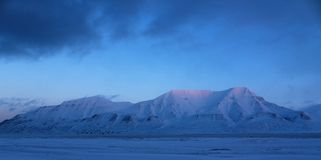 Mountain by the fjord, Svalbard Royalty Free Stock Photo