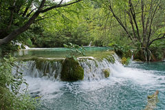 Mountain flowing stream or wild water amaongst the stones Stock Photos