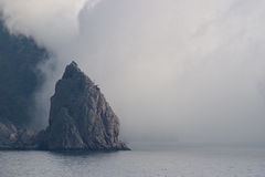 Mountain in a fog Royalty Free Stock Photo