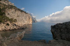 Mountain in a fog. Sea landscape with the mountain closed by a cloud Royalty Free Stock Images