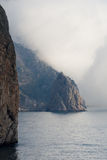 Mountain in a fog Stock Photography