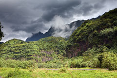Mountain in a fog and clouds and road. Tropical nature. Tahiti. Polynesia. Stock Images
