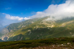 Mountain in fog Stock Image