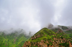 Mountain in fog Stock Photos