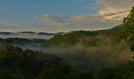 Mountain Fog. Morning fog floating in the valley near Lansing, North Carolina Royalty Free Stock Images