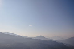 Mountain and fog with orange to blur sky in the morning in winter in Gangtok. North Sikkim, India. Stock Images