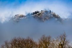 The mountain with a fog scarf stock image
