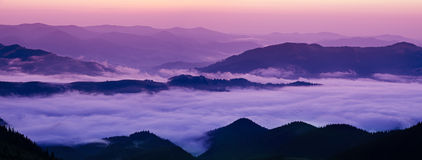 Mountain foggy sunrise Stock Photo
