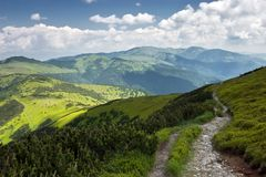 Mountain Footpath with Cloudy Skies in the Summer Stock Photos
