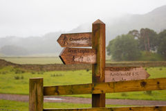 Mountain footpath signpost. Traditional footpath signpost in the Langdale valley, Lake District, United Kingdom, pointing to Chapel Stile, Great Langdale and stock image