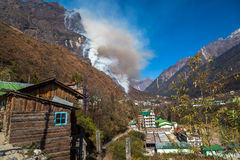 Mountain forest fire burning on a hill in Lachung Sikkim. Stock Images