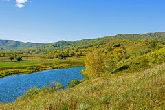 mountain forest and lake in the autumn Royalty Free Stock Image