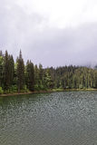 Mountain forest lake with a stormy sky Royalty Free Stock Photography