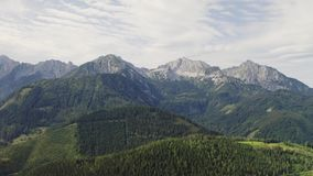 Alps aerial landscape. Mountain and forest landscape aerial view in Alps stock video