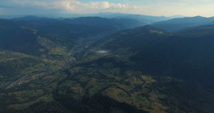 Mountain forest and meadow in summer. Aerial view of summer mountains in Carpathians, Ukraine stock footage