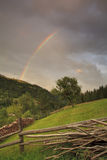 Mountain forest with rainbow Royalty Free Stock Photo