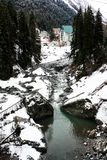 Mountain forest river in winter stock photos