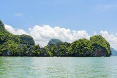Mountain forest and sea water on White cloud on blue sky Royalty Free Stock Image