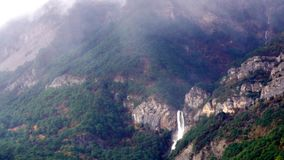 Mountain forests and waterfalls  bad weather stock footage