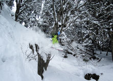 Mountain freeride skier jumping off cliff in deep snow Royalty Free Stock Photos