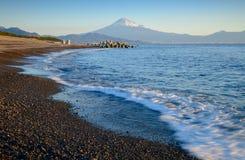 Mountain Fuji and beach at sunrise view from Suruga Bay, Shizuoka, Japan stock images