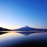 The mountain Fuji at dawn with lake reflection royalty free stock image