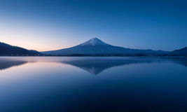 Mountain Fuji at dawn with peaceful lake reflection Stock Photos