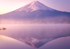 The mountain Fuji at dawn with peaceful lake reflection Stock Photos