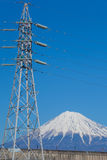 Mountain Fuji with electricity high voltage pole Stock Images