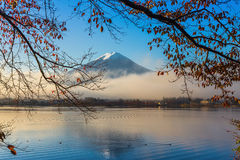 Mountain Fuji and Kawaguchiko lake with morning mist in autumn s Royalty Free Stock Images