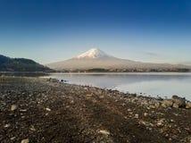 Mountain Fuji reflected in Kawaguchiko lake on a sunny day and clear sky Stock Photography