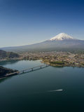 Mountain Fuji reflected in Kawaguchiko lake on a sunny day and clear sky Royalty Free Stock Image