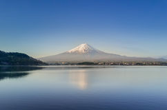 Mountain Fuji reflected in Kawaguchiko lake on a sunny day and clear sky Stock Images