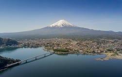Mountain Fuji reflected in Kawaguchiko lake on a sunny day and clear sky Royalty Free Stock Photo