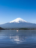 Mountain Fuji reflected in Kawaguchiko lake on a sunny day and clear sky Royalty Free Stock Photos
