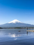 Mountain Fuji reflected in Kawaguchiko lake on a sunny day and clear sky Royalty Free Stock Images
