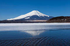 Mountain fuji and reflection on ice lake in winter season at Yamanakako lake Stock Photography