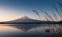 Mountain Fuji and reflections on lake Kawaguchi at dawn Stock Photos