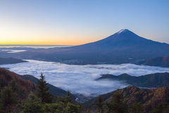 Mountain Fuji and sea of mist above Kawaguchiko lake stock photography