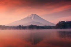 Mountain Fuji and Shoji lake at dawn. Beautiful scenic landscape of mountain Fuji or Fujisan with reflection on Shoji lake at dawn with twilight sky in Yamanashi royalty free stock image