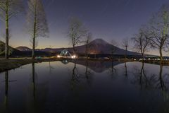 Mountain Fuji and Starry night. In winter stock image