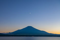 Mountain Fuji after sunset with beautiful moon from Yamanaka lake in summer Stock Photo