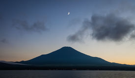 Mountain Fuji after sunset with beautiful moon Royalty Free Stock Images