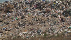 Mountain of garbage waste plastic bottles packages of rotting food. Ackgrounds, bird, bulky, cleanup, concepts, conservation, dirt, dirty, dump, environment stock footage