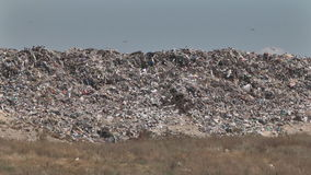 Mountain of garbage waste plastic bottles packages of rotting food stock footage