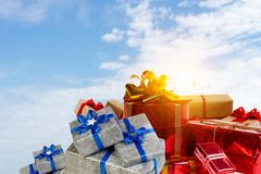 Mountain of gift boxes. Mixed media. Big pile of Christmas gifts as symbol for coming holiday. Mixed media Stock Photo