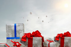Mountain of gift boxes. Mixed media. Big pile of Christmas gifts as symbol for coming holiday. Mixed media Royalty Free Stock Image